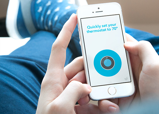 A person uses Do Button on their iPhone to set their Nest Thermostat to seventy degrees.